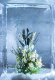 Ice sculpture of flowers in a frozen block of ice Stock Image