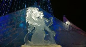 Ice sculpture of a lion. The sculpture by unknown artist was made of pure cristal ice for Winter festival, Perm region, Russia stock image