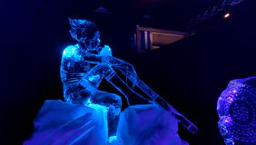 Ice Sculpture man making music. Ice scupture man with music instument Royalty Free Stock Images