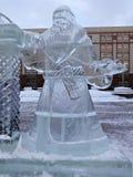 Ice sculpture Santa Claus in a winter city Stock Photos