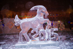 Ice sculpture of the sheep - the sign of 2015 year in Chinese zo. Christmas decoration, illuminated ice sculptures Stock Image