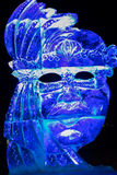 Ice sculpture in Ski resort Bad Gastein, Austria. Photo of woman statue made from ice and lightened. With different colored lamps Royalty Free Stock Photography