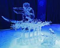 Ice sculpture of surfer, illuminated at night in Confederation Park Stock Photo