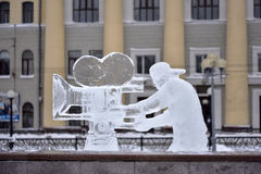 Ice sculpture videographer with a camera Royalty Free Stock Image
