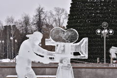Ice sculpture videographer with a camera Stock Photography