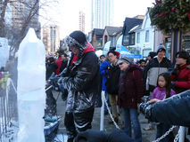 Ice Scuplture Making. At Festival IceFest 2014 in Bloor-Yorkville park in February 22-23, 2014 in Toronto, Canada Stock Photography