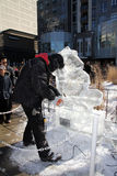 Ice Scuplture Making. At Festival IceFest 2014 in Bloor-Yorkville park in February 22-23, 2014 in Toronto, Canada Royalty Free Stock Photo