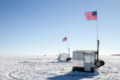 Ice Shanties on Frozen Lake with American Flags