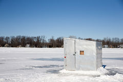 Ice Shanty on a Frozen Lake. A lone ice shanty sitting on a frozen lake.  Copy space in the sky.  Photograph taken on Lake Winnebago, Wisconsin.  Concepts could Stock Photos