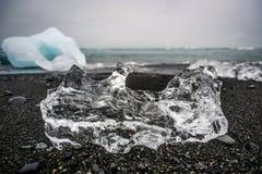 Ice sheet lying on a black beach in Iceland, ocean coast near J stock photos