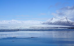 Ice sheet on the water with snow mountain background. In Iceland Stock Images