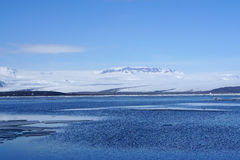 Ice sheet on the water with snow mountain background. In Iceland Royalty Free Stock Photos