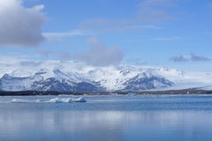 Ice sheet on the water with snow mountain background. In Iceland Stock Photos