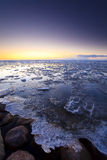 Ice shelves at sunset on a frozen lake Stock Photography