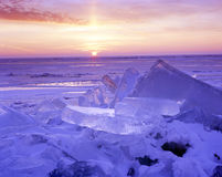 Ice Shove Sunrise. Ice piles up on the shore of a lake after strong winds cause the ice sheet to move like a glacier Royalty Free Stock Photography
