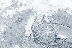 Ice with show on frozen river in winter stock image
