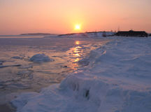 Ice silence. The frozen sea on a background of a sunset Royalty Free Stock Photo