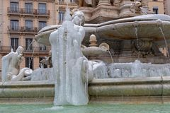 Ice on the sirens of Jacobins fountain. LYON, FRANCE, March 1, 2018 : Fountain of Place des Jacobins, as a cold spell rages in all Europe and the Capital of Royalty Free Stock Photography