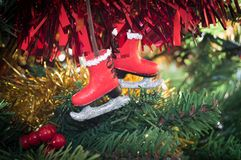 Christmas decoration of an Ice Skate on tree Royalty Free Stock Image