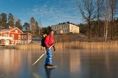 Ice skater. A male ice skater on a frozen lake. Orlangen, Stockholm, Sweden Royalty Free Stock Images