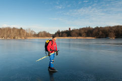 Ice skater. A male ice skater on a frozen lake. Orlangen, Stockholm, Sweden royalty free stock photography