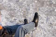 Ice skater sitting on ice stock images