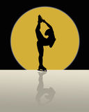 Ice Skater Skating In The Moonlight. Silhouette of female ice skater skating in front of gold colored full moon Royalty Free Stock Photos