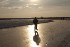 Ice skater on Zuidlaardermeer Stock Photography