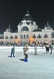Ice skaters in City Park Ice Rink, Budapest Royalty Free Stock Photography