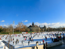 Ice skaters in City Park  Rink in Budapest, Hungary. Royalty Free Stock Photography