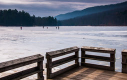 Ice skaters on a frozen lake at Cowans Gap State Park, PA Royalty Free Stock Images
