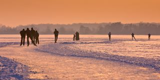 Ice Skaters on frozen lake Royalty Free Stock Images