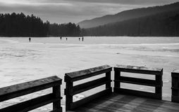 Ice skaters on the frozen surface of Cowans Gap Lake, near McCon Royalty Free Stock Images