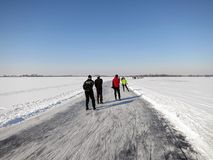 Ice skaters in frozen winter landscape in Holland Stock Images