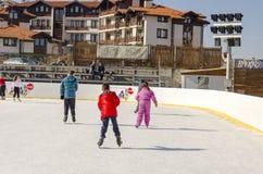 Ice skaters having fun in Bansko in winter royalty free stock image