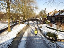 Ice skaters having recreation in Holland. Giethoorn, Netherlands - February 6, 2012. Ice skaters in Dutch winter landscape Royalty Free Stock Photos
