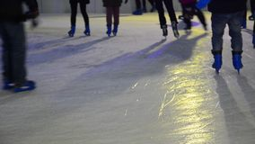 Ice skaters at a public ice skating rink Stock Photos