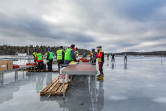 Ice skaters at a rest area taking a break and voluntary workers serving drinks. Stock Photography