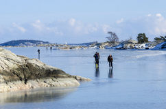Ice skaters in Stockholm archipelago Royalty Free Stock Photography