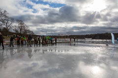 Ice skaters and volunteers at a resting area on the ice. Royalty Free Stock Photos