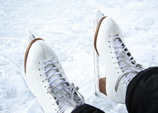 Ice skates. Closeup of classical figure skating  on ice outdoors on lake in Quebec, Canada Stock Images