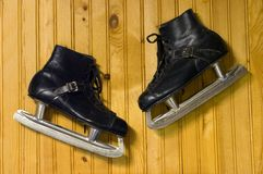 Ice skates. A pair of ice skates hanging on the wall Stock Photography
