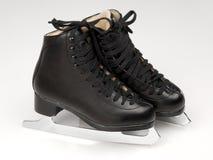 Ice skates. Black pair of ice skates on ice Stock Photography