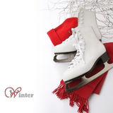 Ice skates. Cap and scarf on the white background Stock Images