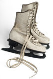 Ice skates. An old pair of figure ice skates isolated on white Royalty Free Stock Photography