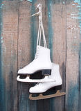 Ice Skates. Hanging on weathered door Royalty Free Stock Images