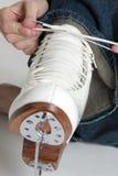 Ice Skates. Tying laces on ice skates Royalty Free Stock Images