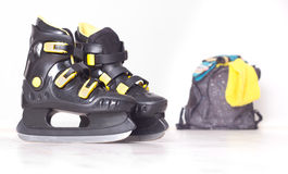 Ice skates and backpack Stock Images