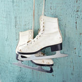 Ice skates on blue vintage wooden background Royalty Free Stock Photo