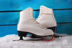 Ice skates on blue wooden background Stock Photography